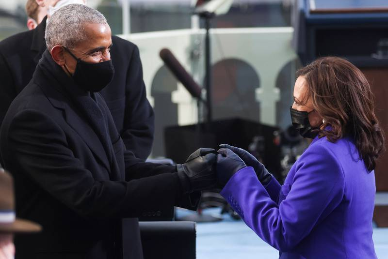 Former President Barack Obama, left, bumps fists with Vice President-elect Kamala Harris as they arrive for the inauguration of Joe Biden as the 46th president on the West Front of the Capitol in Washington on Jan. 20, 2021.