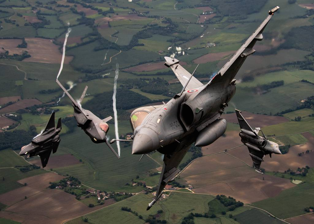 Two U.S. Air Force F-35A Lightning IIs assigned to Hill Air Force Base, Utah, and two Dassault Rafales assigned to Saint-Dizier-Robinson Air Base, France, break formation during flight May 18, 2021, over France. The flight was a part of exercise Atlantic Trident 21, a joint, multinational exercise involving service members from the U.S., France and the United Kingdom. (Staff Sgt. Alexander Cook/Air Force)
