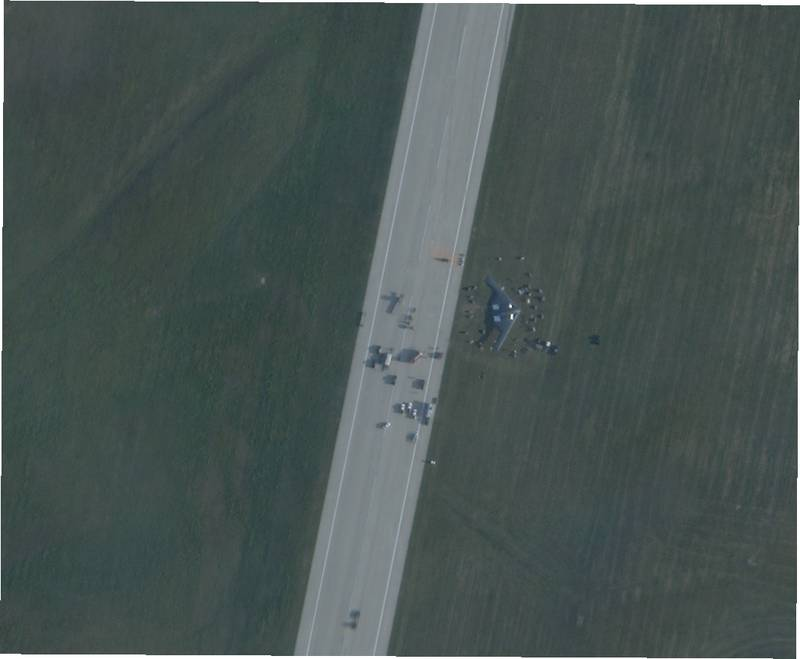 Satellite imagery provided by Planet Labs shows a B-2 Spirit bomber next to the runway at Whiteman Air Force Base, Missouri, after it suffered an in-flight malfunction and crash-landed shortly after midnight on Sept. 15, 2021. The photo was taken at 8:24 am local time. Photo courtesy of Planet Labs.