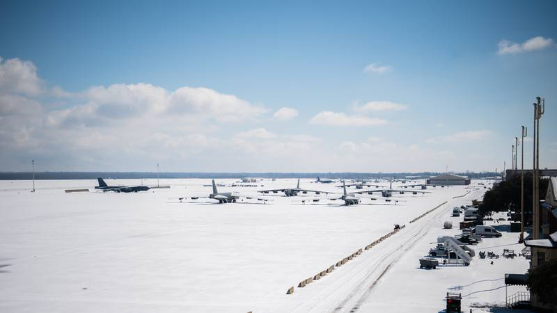 Snow covered B-52H Stratofortresses sit on the flightline at Barksdale Air Force Base, La., Feb. 19, 2021. Barksdale measured approximately four inches of snow Feb. 14 and 15. An additional two inches of snow and sleet were recorded on Feb. 17. (Air Force/Airman 1st Class Jacob Wrightsman)