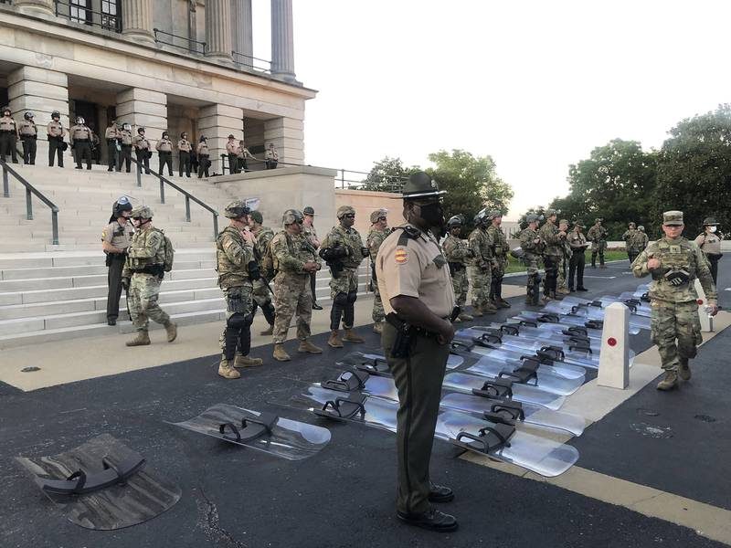 National Guard troops lay down their shields at the request of protesters in Nashville, Tenn., Monday, June 1, 2020.