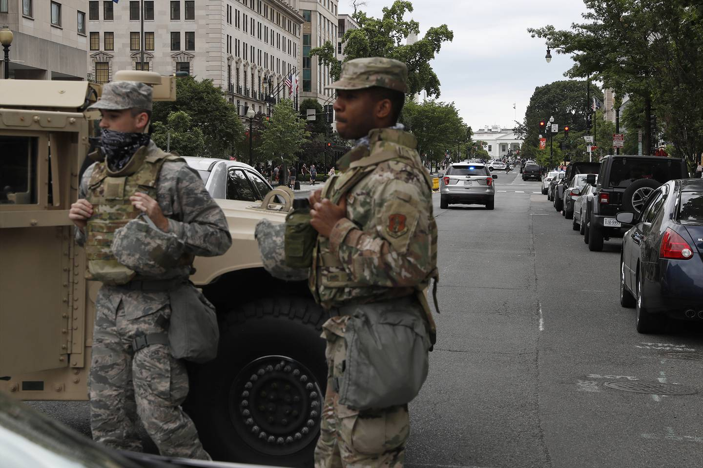 Members of the D.C. National Guard block an intersection on 16th Street as demonstrators gather to protest the death of George Floyd, Tuesday, June 2, 2020, near the White House in Washington.