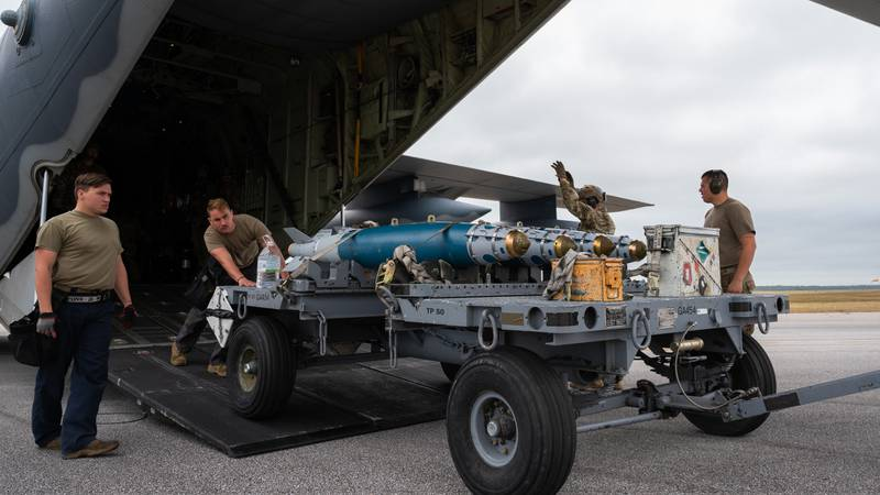 Airmen assigned to Air Force Special Operations Command and Air Combat Command offload a cart of GBU-38 joint direct attack munitions from an MC-130J Commando II assigned to the 9th Special Operations Squadron during Agile Flag 21-1 at Hurlburt Field, Florida, Oct. 27, 2020. Airmen assigned to AFSOC and ACC conducted a forward area refueling point operation and rearmed GBU-38s to two F-15E Strike Eagle assigned to the 389th Fighter Squadron, displaying the forces ability to be adaptable, survivable, and combat-ready for combatant commanders in the future. (Staff Sgt. Joseph Pick/Air Force)