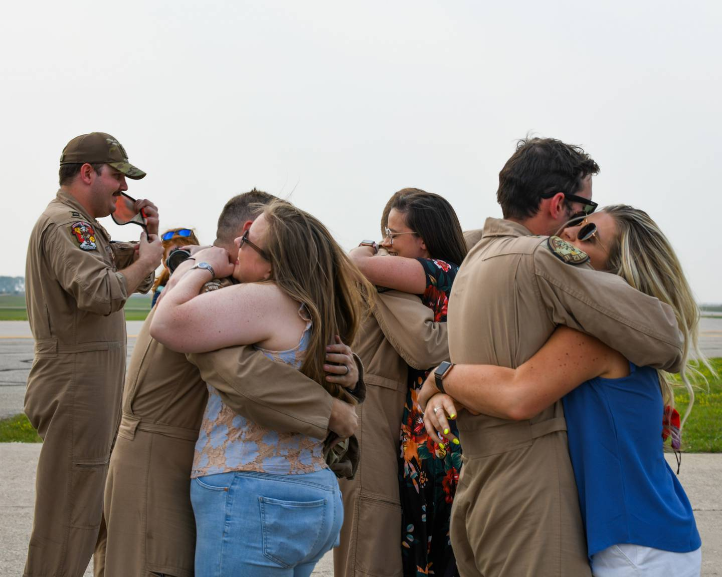 Spouses at Minot Air Force Base, North Dakota, reunited with their husbands who safely returned from deployment on Sept. 10, 2021. The aircrews that arrived were from the 23rd Bomb Squadron. (Airman 1st Class Saomy Sabournin/Air Force)