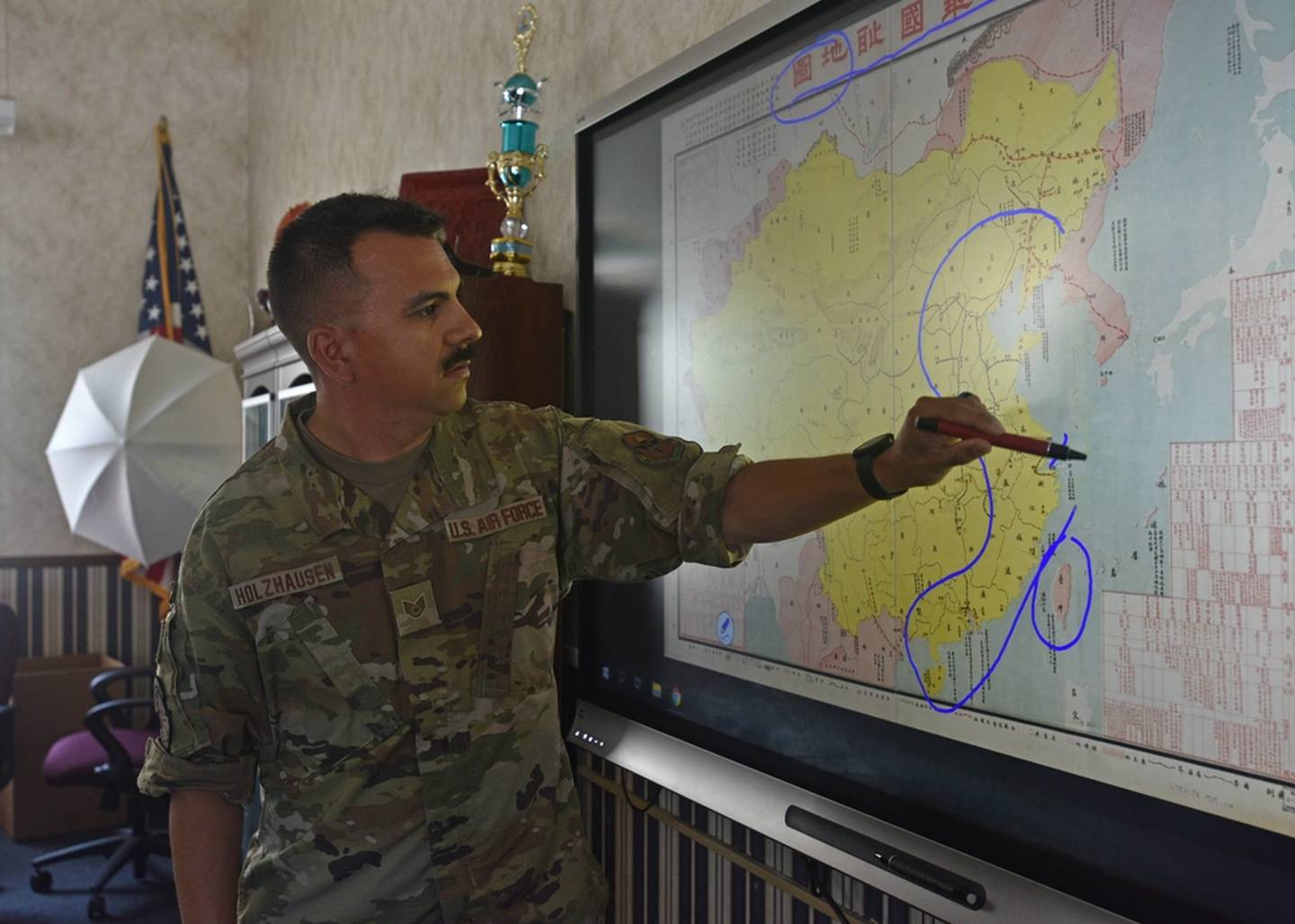 Air Force Staff Sgt. Uruwishi Holzhausen, 314th Training Squadron military language instructor, discusses the geography of China at the Presidio of Monterey, California, July 21, 2021. (Senior Airman Ashley Thrash/Air Force)