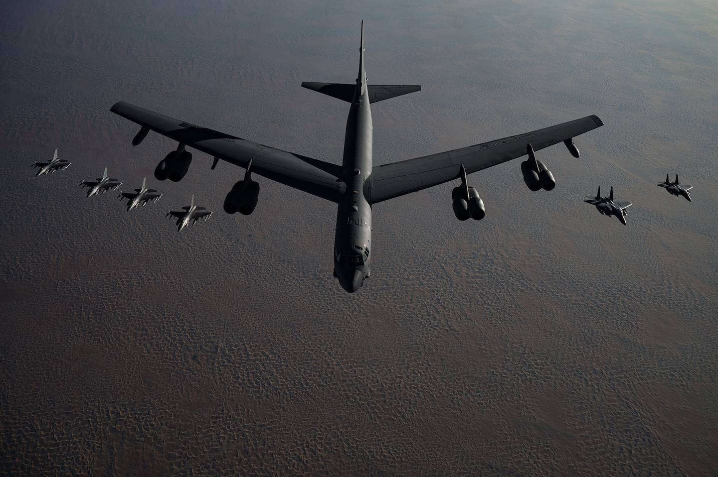 A B-52 Stratofortress flies in formation with F-16 Fighting Falcons and F-15E Strike Eagles during a Bomber Task Force mission over the U.S. Central Command area of responsibility, Nov. 21, 2020.