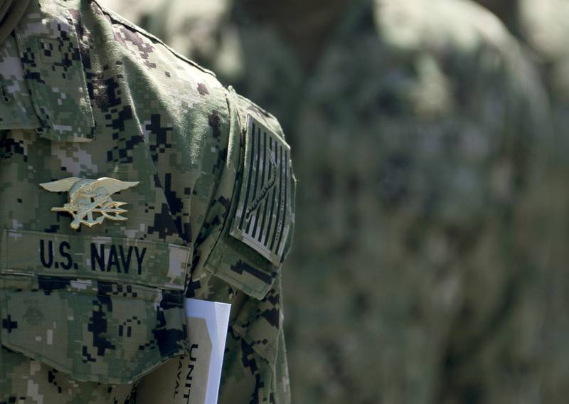 """Members of SEAL Qualification Training Class 336 wear their newly earned Special Warfare (SEAL) pins, known as """"Tridents,"""" during their graduation ceremony at Naval Special Warfare (NSW) Center in Coronado, Calif., April 15, 2020."""