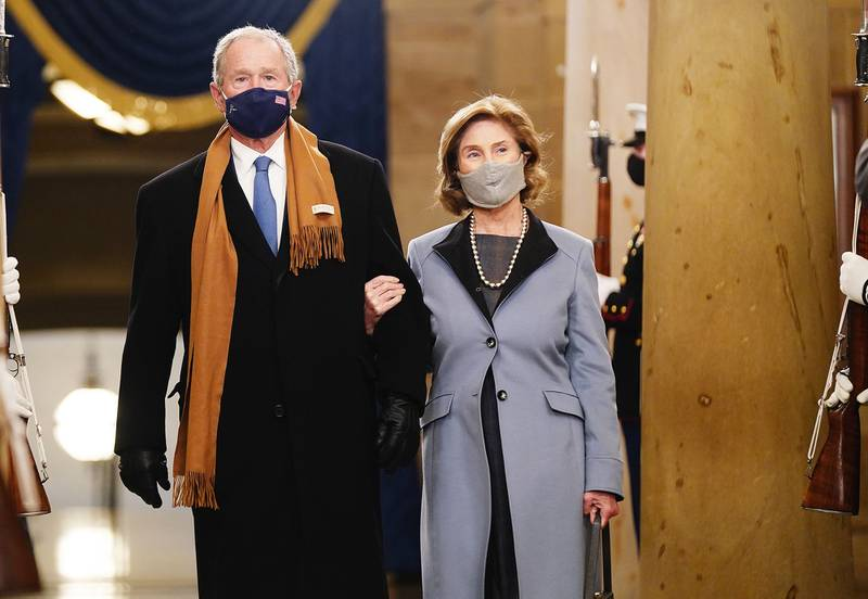 Former President George W. Bush and Laura Bush arrive before President-elect Joe Biden is sworn in as the 46th president on Jan. 20, 2021, at the Capitol in Washington.