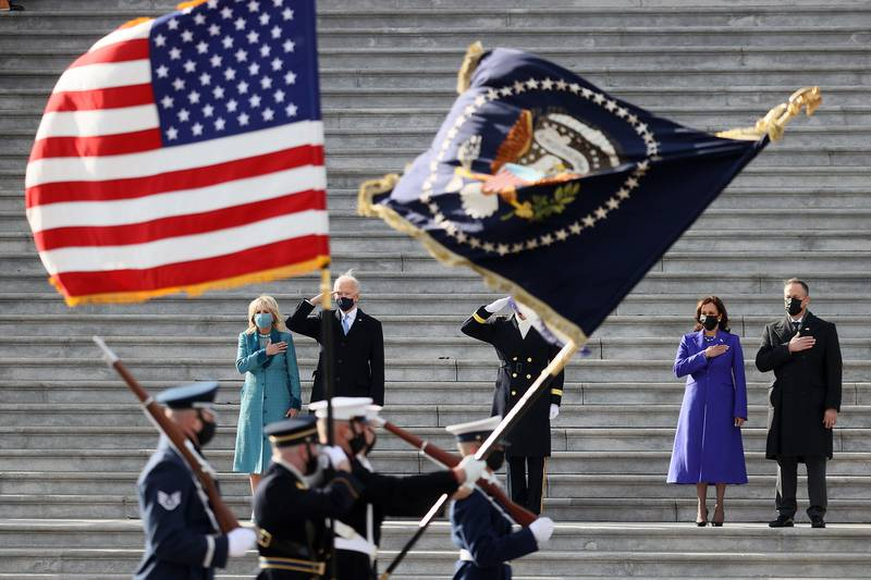 President Joe Biden, first lady Dr. Jill Biden, Vice President Kamala Harris and Douglas Emhoff, husband of Vice President Harris, attend a Pass-in-Review ceremony, hosted by the Joint Task Force-National Capital Region on the East Front of the U.S. Capitol after the 59th Presidential Inauguration on Jan. 20, 2021 in Washington.