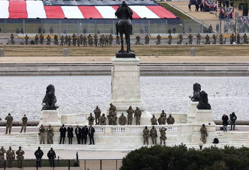 National Guard troops look on during the inauguration of President-elect Joe Biden on the West Front of the Capitol on Jan. 20, 2021, in Washington.