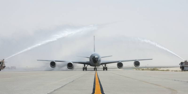 Fire engines with the U.S. Air Force 379th Expeditionary Civil Engineer Squadron Fire Department give U.S. Air Force Brig. Gen. Darren James, the commander of the 379th Air Expeditionary Wing, a water salute after completing his fini-flight at Al Udeid Air Base, Qatar, May 29, 2017.