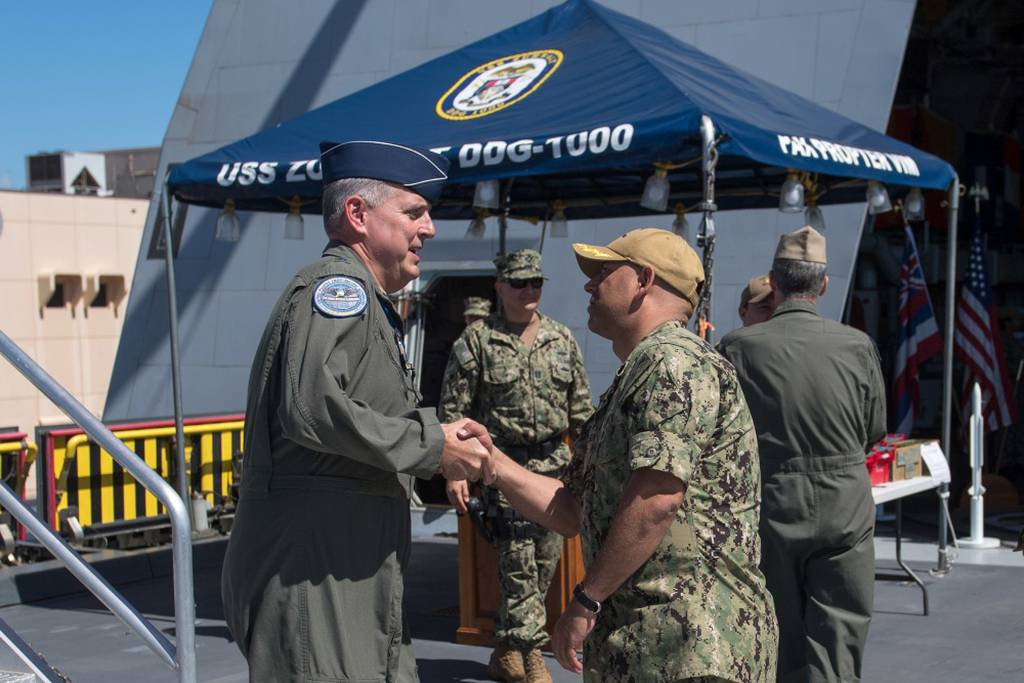 Capt. Andrew Carlson, commanding officer of guided-missile destroyer USS Zumwalt, shakes hands with then-U.S. Indo-Pacific Command Chief of staff Maj. Gen. Mike Minihan (left) on the flight deck. (Specialist 2nd Class Jonathan Jiang/Navy)