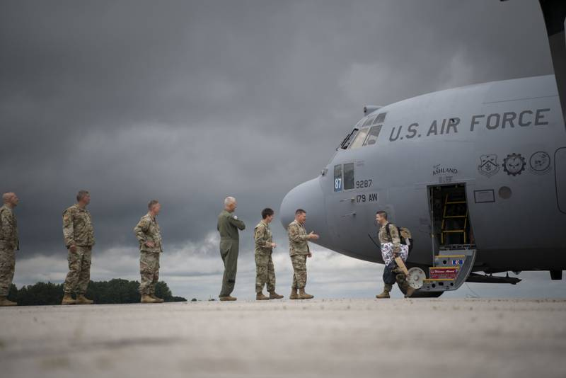 The last rotations of airmen from the 179th Airlift Wing, Mansfield, Ohio, return to their home station in a C-130H Hercules, July 9, 2021. The 164th Airlift Squadron and 179th Maintenance Group have completed their missions flying and maintaining the C-130H aircraft in support of Operation Spartan Shield. (Master Sgt. Joe Harwood/Air National Guard)