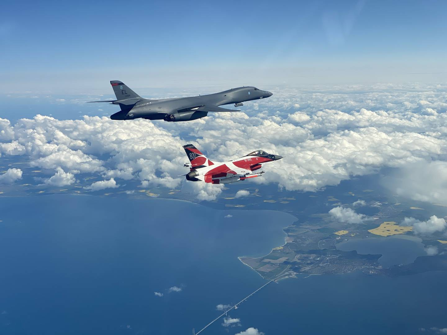 A B-1B Lancer flies with a Danish F-16 during a training mission for Bomber Task Force Europe, May 5, 2020.