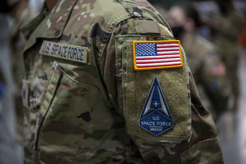 U.S. airmen assigned to Travis Air Force Base, Calif., transition into the U.S. Space Force during a ceremony at the 621st Contingency Response Wing, Feb. 12, 2021