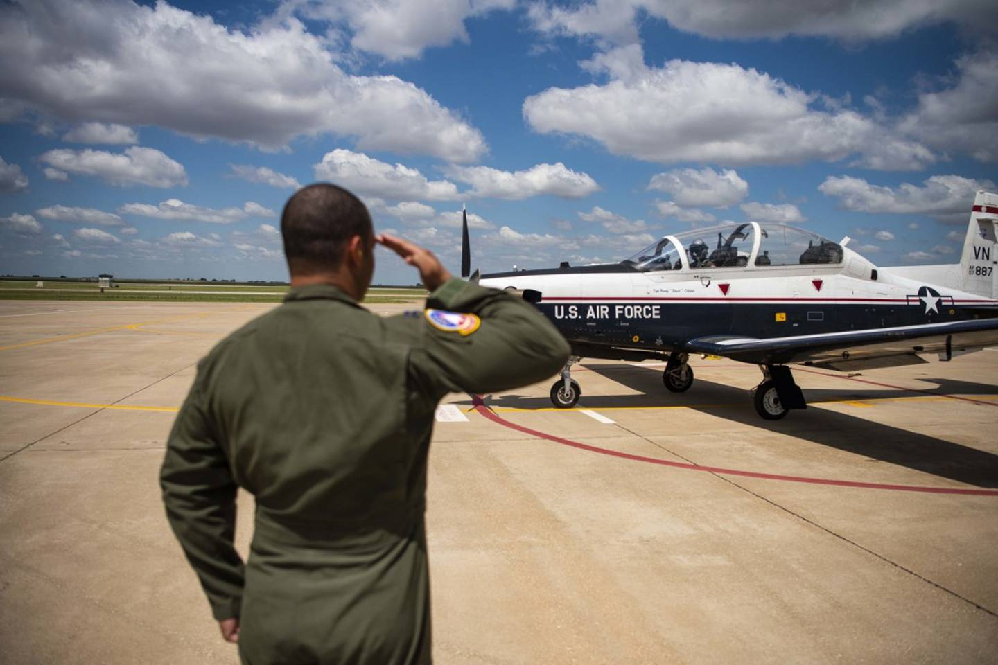 Capt. Marcel Trott, a flight commander assigned to the 71st Student Squadron, salutes 2nd Lt. Corey Persons, a student pilot assigned to the 71st SS, before his solo flight July 15, 2019, at Vance Air Force Base, Oklahoma. (Air Force/SrA Taylor Crul)
