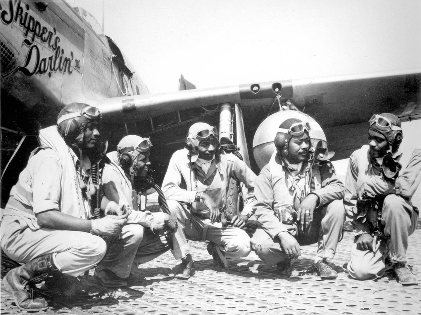(From left) Lt. Dempsey W. Morgan, Lt. Carrol S. Woods, Lt. Robert H. Nelson Jr., Capt. Andrew D. Turner and Lt. Clarence D. Lester, shown in Ramitelli, Italy, were pilots with the 332nd Fighter Group. The airmen with the elite, all-black fighter group were better known as Tuskegee Airmen. (U.S. Air Force photo)