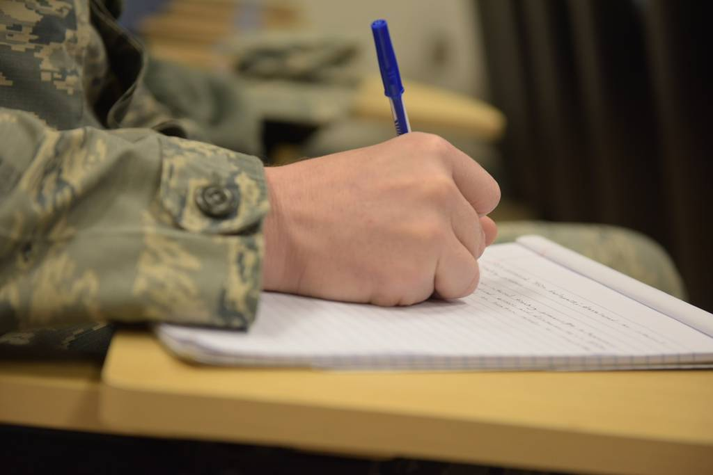 Staff Sgt. Matthew Shannon, of the individual personnel readiness office with the 911th Force Support Squadron, takes notes during an enlisted performance report bullet writing seminar at the Pittsburgh International Airport Air Reserve Station, April 8, 2018. The EPR bullet writing seminar was conducted by Chief Master Sgt. Chin Cox, the Office of the Joint Staff Surgeon Senior Enlisted Leader at the Pentagon, to improve airmen's writing skills. (Airman 1st Class Grace Thomson/Air Force)