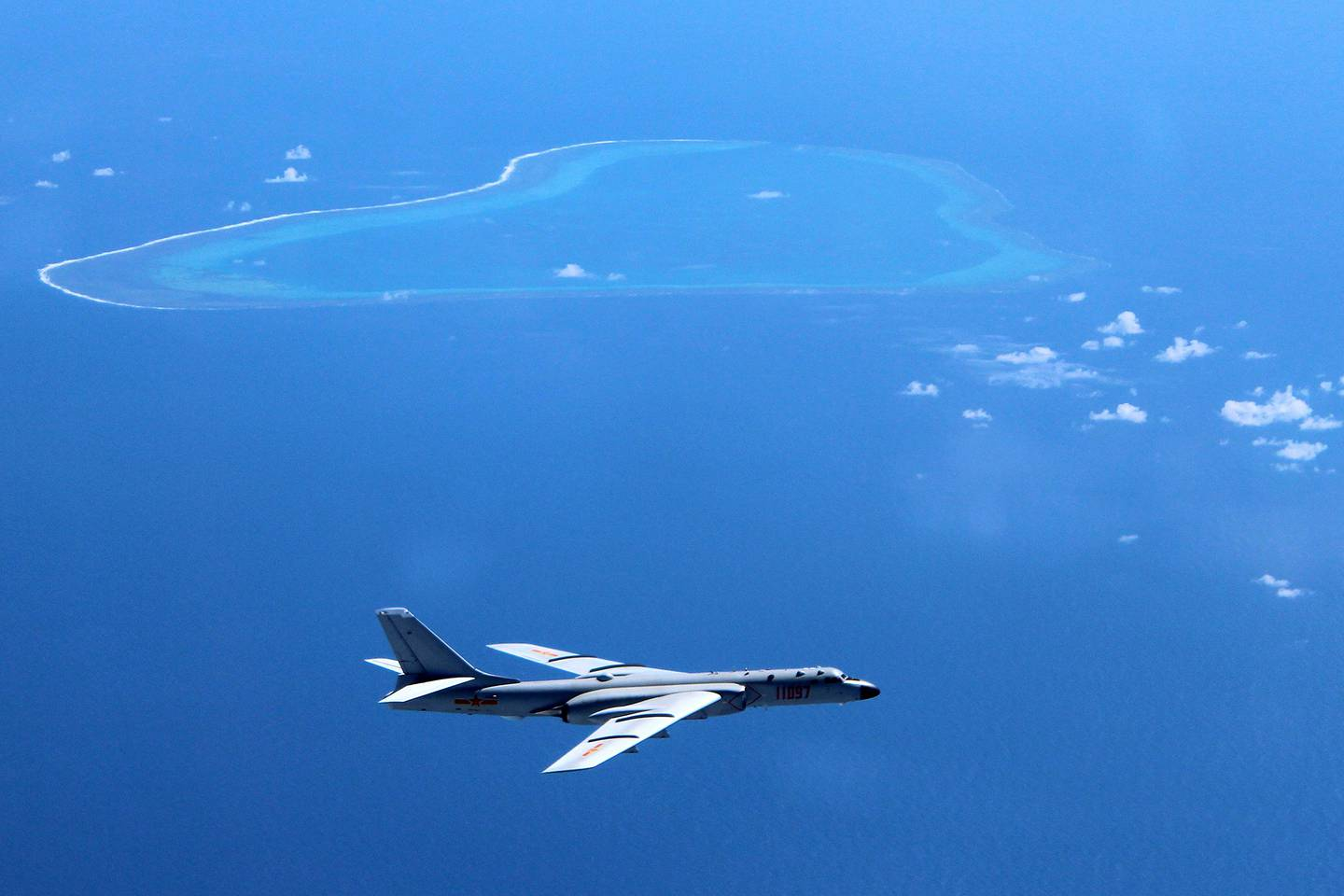 A Chinese H-6K bomber patrols the islands and reefs in the South China Sea in this undated photo.