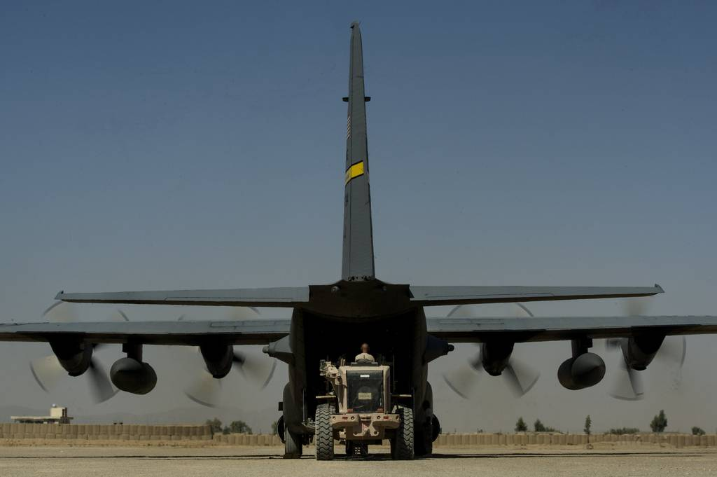U.S. Air Force Air Mobility Division personnel load retrograde cargo on to an U.S. Air National Guard C-130H Hercules at Forward Operating Base Farah in western Afghanistan, Oct. 20, 2013. The C-130H is deployed from the 153rd Airlift Wing, Wyoming ANG.
