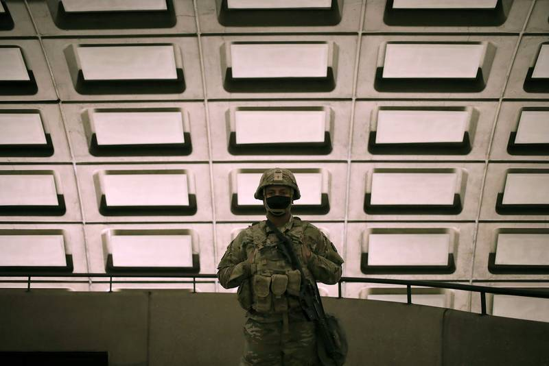 Soldiers from the North Carolina Army National Guard patrol the Rosslyn Metro station on the morning of the inauguration on Jan. 20, 2021, in Arlington, Va.