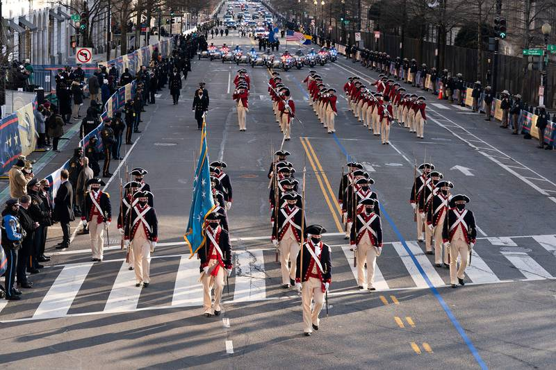 Members of the military march on 15th Street towards the White House during a presidential escort to the White House  following President Joe Biden taking the oath of office in Washington on Jan. 20, 2021.
