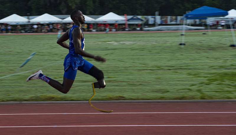 Air Force Staff Sgt. Kevin Greene, Team Air Force athlete, competes in the 200-meter dash during the Department of Defense Warrior Games track competition in Tampa, Fla., June 22, 2019.