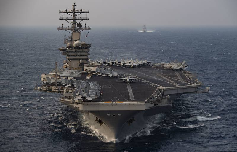 The aircraft carrier USS Nimitz (CVN 68) steams ahead of the guided-missile cruiser USS Princeton (CG 59) while participating in Malabar 2020 in the north Arabian Sea on Nov. 17, 2020.
