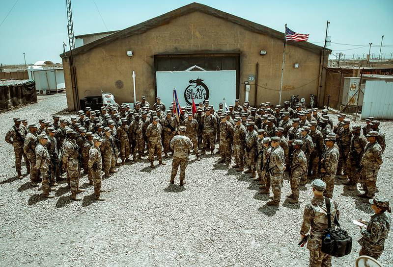 """Maj. Gen. Flem B. """"Donnie"""" Walker, commanding general of 1st Theater Sustainment Command, speaks with Task Force Cavalier Soldiers of the 529th Support Battalion, 574th Quartermaster Company, and 183d Maintenance Company at Camp Taji, Iraq, June 8, 2019."""