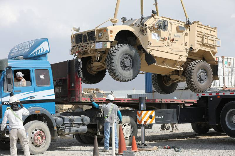 A Mine Resistant Ambush Protected vehicle is loaded on a flatbed trailer as part of the Army Field Support Battalion - Afghanistan, 10th Mountain Division Resolute Support Sustainment Brigade retrograde cargo operation on Bagram Air Field, Afghanistan, July 12, 2020.
