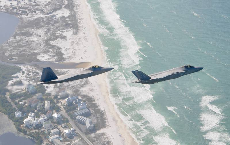 A F-22 Raptor from the 325th Fighter Wing flies alongside a F-35 Lightning II from the 33rd Fighter Wing over the Emerald Coast. Tyndall Air Force Base, Fla., will receive three F-35 squadrons starting in 2023. (Air Force/1st Lt. Savanah Bray)