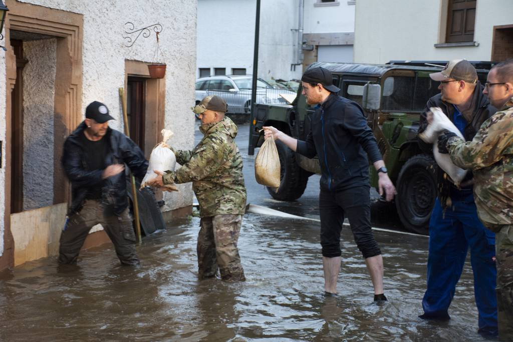 Members from the 52nd Civil Engineer Squadron from Spangdahlem Air Base, Germany, work with German first responders and community members to lay sandbags in the town of Binsfeld, Germany, July 14, 2021. The 52 CES was able to fill and deliver around 1,800 sandbags to help protect homes and businesses in the communities of Binsfeld and Neiderkail after heavy rainfall caused severe flooding in the region. (Tech. Sgt. Warren Spearman/Air Force photo)
