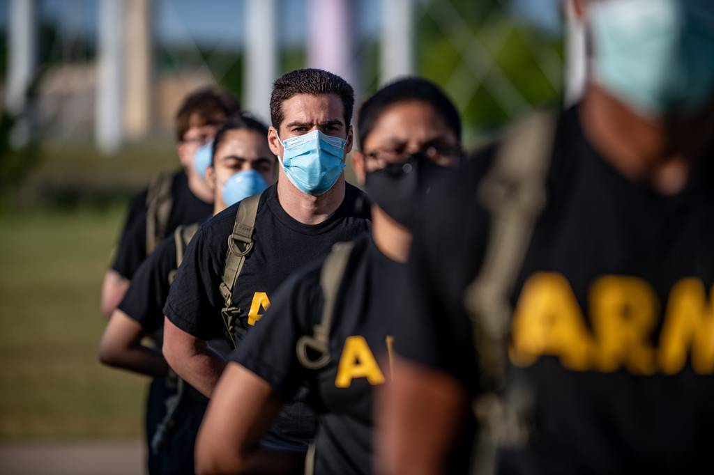 Soldiers from 95th Adjutant General Battalion, 434th Field Artillery Brigade, Fort Sill, Okla., stand in formation while wearing masks and maintaining physical distancing during reception before entering basic combat training May 14, 2020, on Fort Sill.