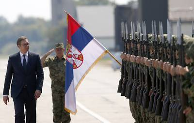 In this Aug. 21, 2018, file photo, Serbian President Aleksandar Vucic, left, reviews an honor guard on the tarmac at Batajnica, military airport near Belgrade, Serbia.