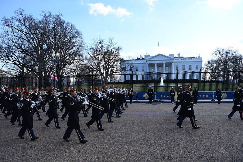 A military band parades on the street near the White House after President Joe Biden and Vice President Kamala Harris were sworn in at the Capitol on Jan. 20, 2021, in Washington.