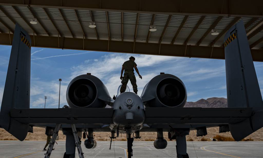 Airman 1st Class Zane Campbell, tactical aircraft maintainer assigned to the 757th Aircraft Maintenance Squadron, performs routine maintenance on an A-10 Thunderbolt II at Nellis Air Force Base, Nevada, June 26, 2021. The A-10 has excellent maneuverability at low air speeds and altitude while providing a highly accurate weapons delivery system. (Airman 1st Class Zachary Rufus/Air Force)