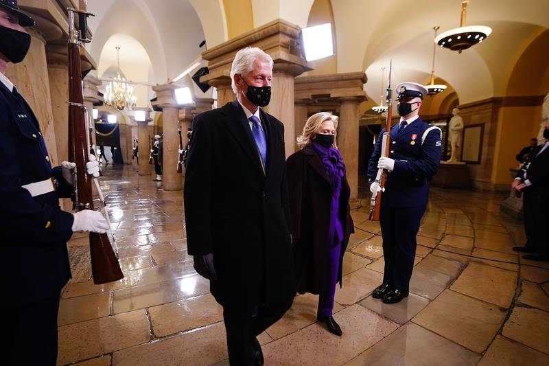 Former President Bill Clinton arrives with former Secretary of State Hillary Clinton before the inauguration of President-elect Joe Biden as the 46th president of the United States on the West Front of the Capitol in Washington on Jan. 20, 2021.