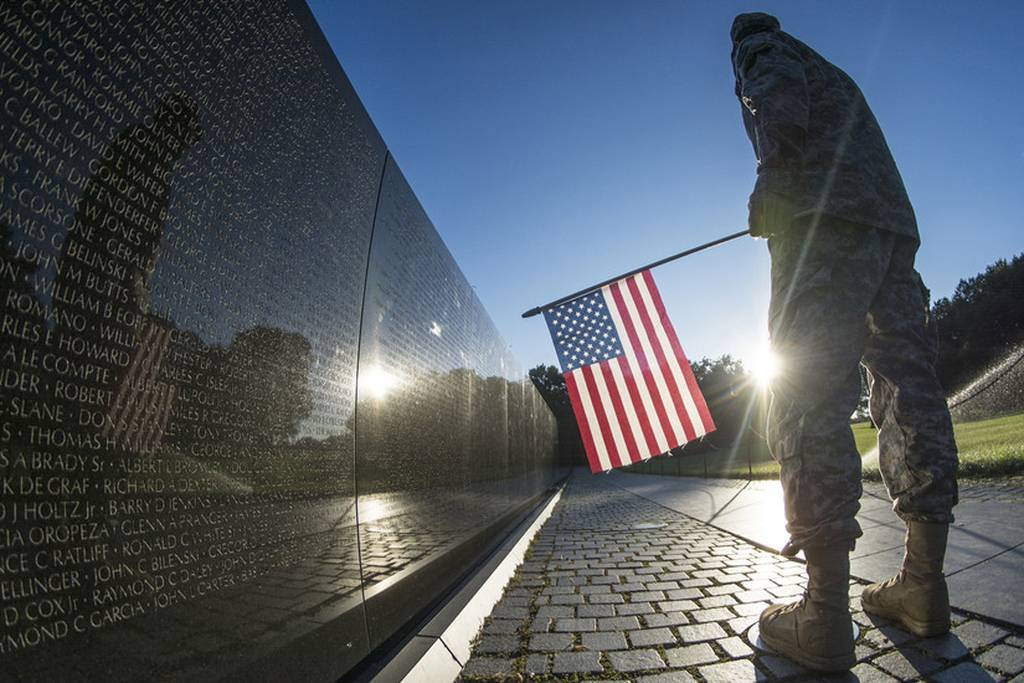 Soldier at the Vietnam Memorial wall