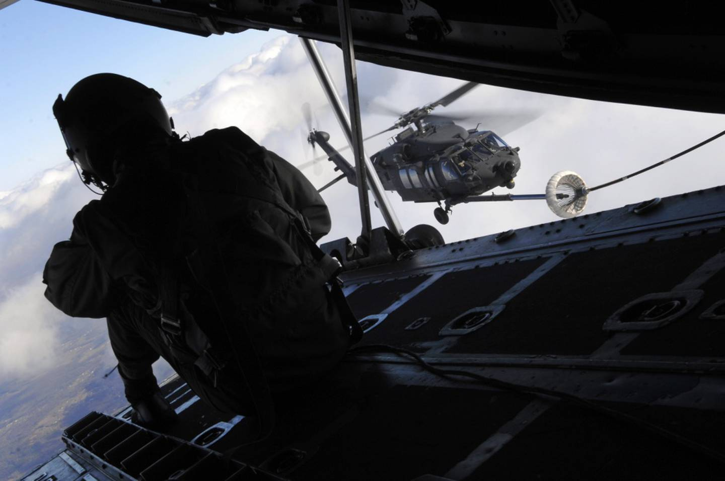 Staff Sgt. Jeremy Mayo, a 9th Special Operations Squadron loadmaster aboard a C-130P, looks for signs of difficulty during an aerial refueling mission over Fort Campbell, Kentucky, Dec. 2, 2008. (Senior Airman Julianne Showalter/Air Force)