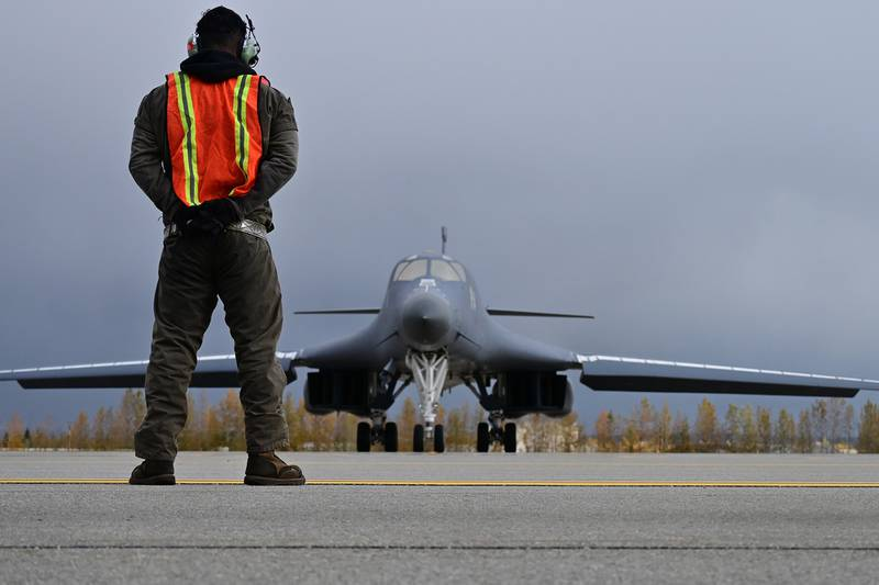 U.S. Air Force Technical Sgt. Rory Riggs marshals a B-1 Lancer at Eielson Air Force Base, Alaska, Sept. 10, 2020.