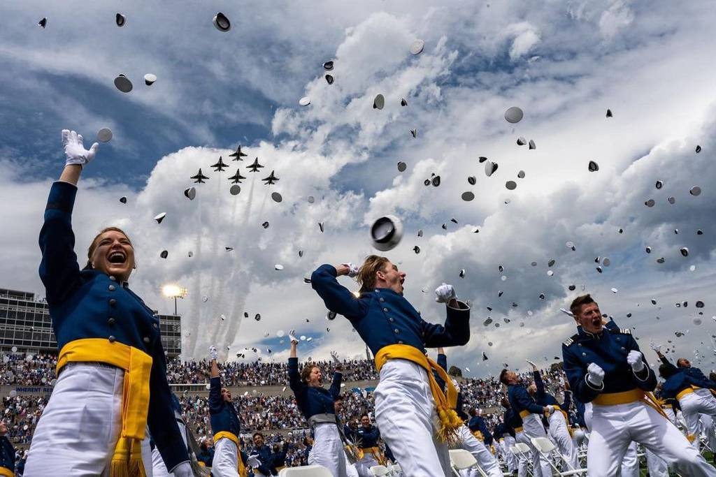 U.S. Air Force Academy cadets toss their caps at the end of a graduation ceremony in Colorado Springs, Colorado. More than 1,000 young adults graduated from the school on May 26, 2021. (Air Force photo)