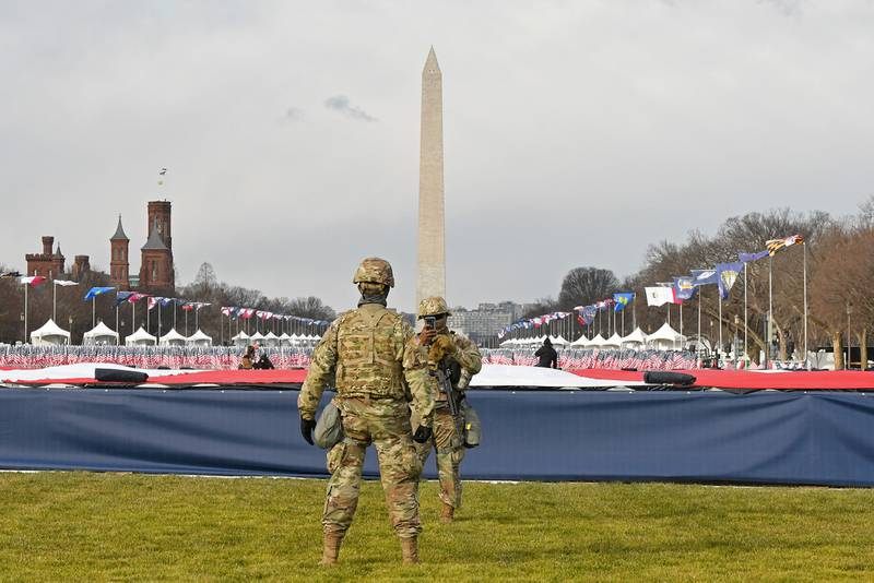 Members of the National Guard stand on the National Mall near the U.S. Capitol before the inauguration of President-elect Joe Biden and Vice President-elect Kamala Harris on Jan. 20, 2021, in Washington.