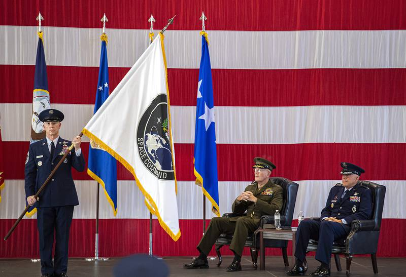Air Force Gen. John W. Raymond, commander of the U.S. Space Command, right, and Marine Corps Gen. Joseph F. Dunford Jr., chairman of the Joint Chiefs of Staff, watch during the presentation of the new U.S. Space Command colors Monday, Sept. 9, 2019, during a ceremony to recognize the establishment of the United States Space Command at Peterson Air Force Base in Colorado Springs, Colo.