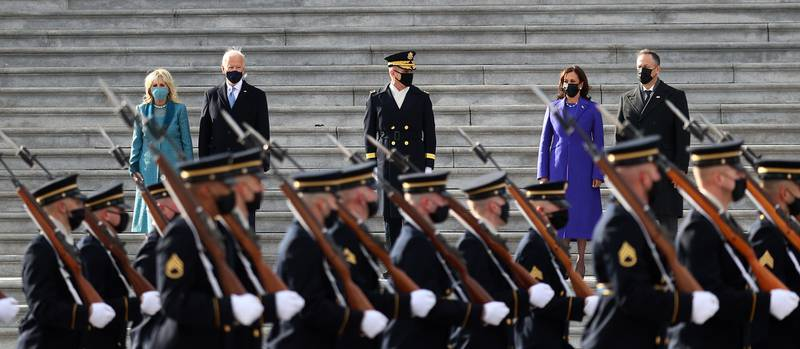 From left to right: first lady Dr. Jill Biden, President Joe Biden, Vice President Kamala Harris, and Doug Emhoffl, Harris' husband, watch a military pass-in-review during the inauguration on the West Front of the Capitol on January 20, 2021 in Washington.