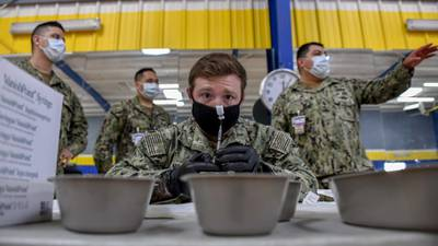Hospital Corpsman 2nd Class Shane Miller prepares COVID-19 vaccines at the Naval Base San Diego fitness center on Jan. 8, 2020, as part of Operation Warp Speed.