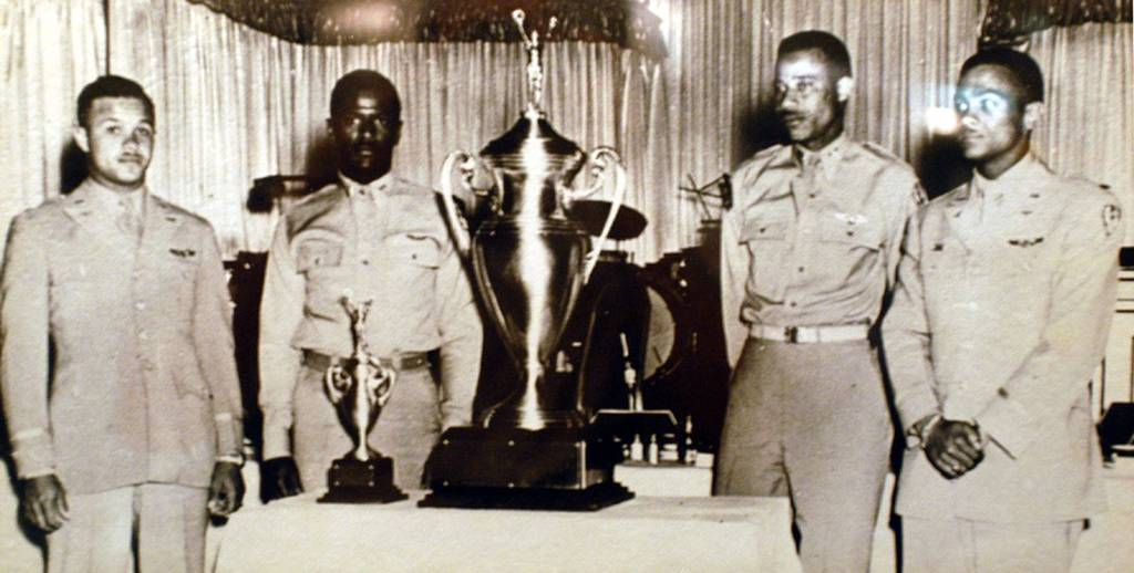 U.S. Air Force Capt. Alva Temple, 1st Lt. James Harvey, 1st Lt. Harry Stewart and 1st Lt. Halbert Alexander pose with their 1949 Weapons Meet trophy in May 1949 at the Flamingo Hotel in Las Vegas, Nev. (U.S. Air Force photo)