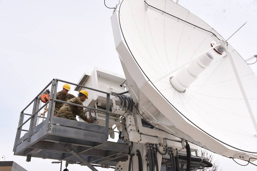 Soldiers with the 53rd Signal Battalion work on an antenna at the Wideband Satellite Communications Operations Center at Fort Meade, Maryland, on March 29, 2018. The Satellite Operations Brigade executes continuous tactical, operational and strategic satellite communications payload management in support of combatant commands, services, U.S. government agencies and international partners. (Carrie David Campbell/Army)