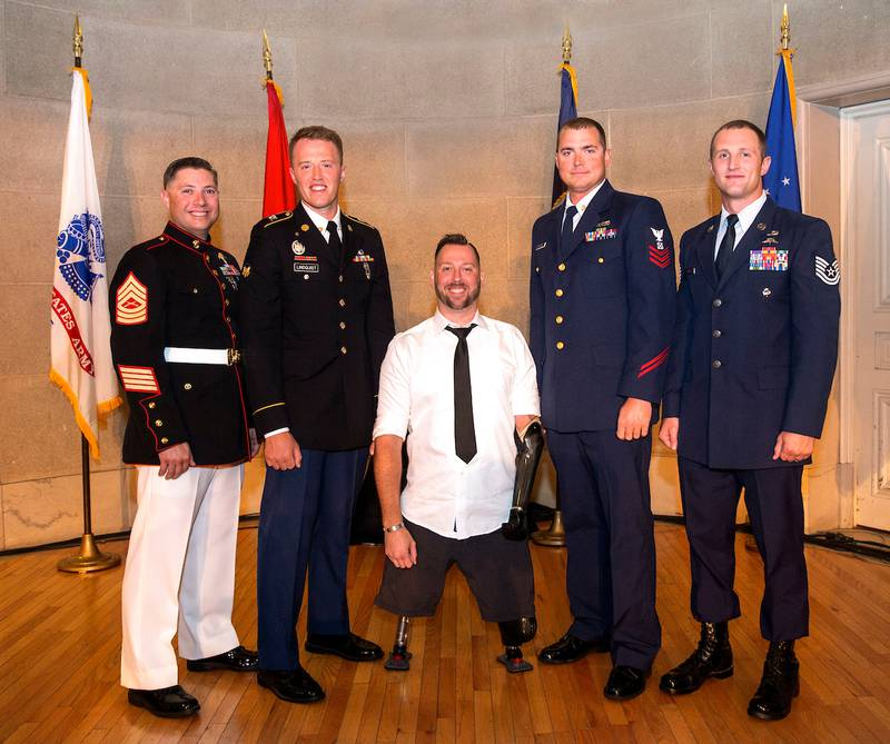 2019 Service Members of the Year, from left: Master Sgt. Jarad Stout, Spc. Shayn Lindquist, Army veteran Adam Keys, Boatswain's Mate 1st Class Nathan Reynolds and Tech. Sgt. Cody Smith.
