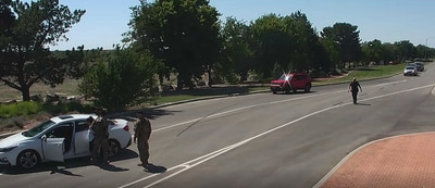 A screenshot of closed-circuit television footage of a June 26, 2021, incident provided by Mountain Home Air Force Base, Idaho, shows Tati Gonzalez being handcuffed after security forces Tech. Sgt. Ryan Green breaks her car window with a baton.
