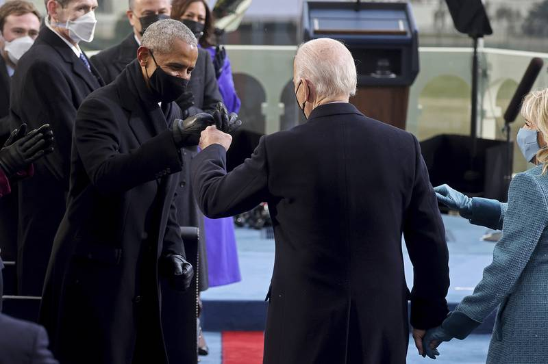 President-elect Joe Biden bumps fists with former President Barack Obama during Biden's inauguration, Wednesday, Jan. 20, 2021, at the U.S. Capitol in Washington.